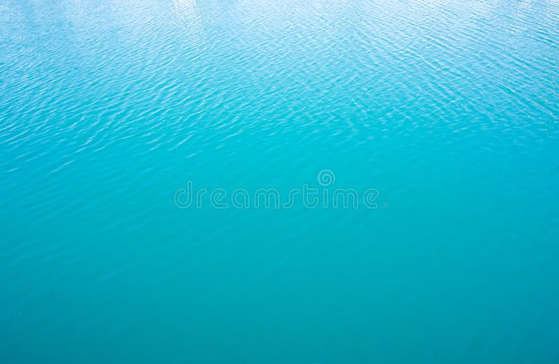 Calm blue sea water surface. Natural background. Calm tranquil blue sea water surface. Natural background with wavy ripples stock photo