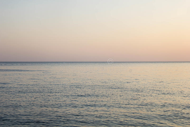 Calm Blue sea waves soft surface Ocean And Blue Sky Background stock photography