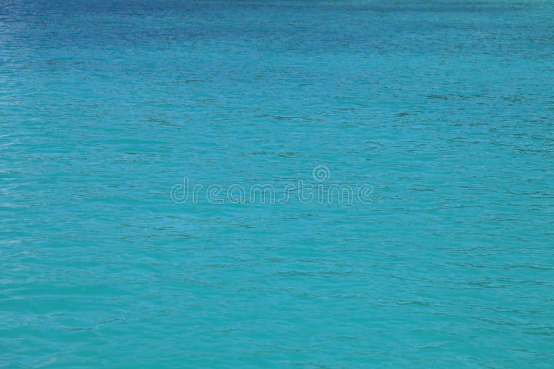 Calm blue / turquoise water surface for background - ocean stock photo