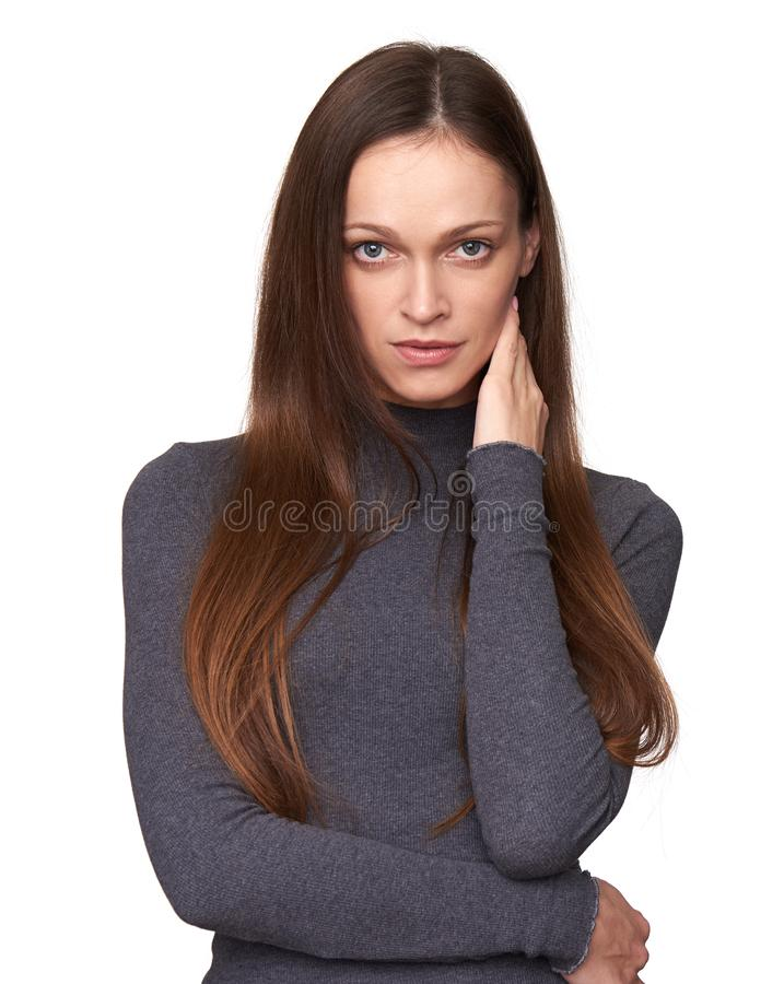 Calm brunette woman looking at camera. Isolated royalty free stock photos