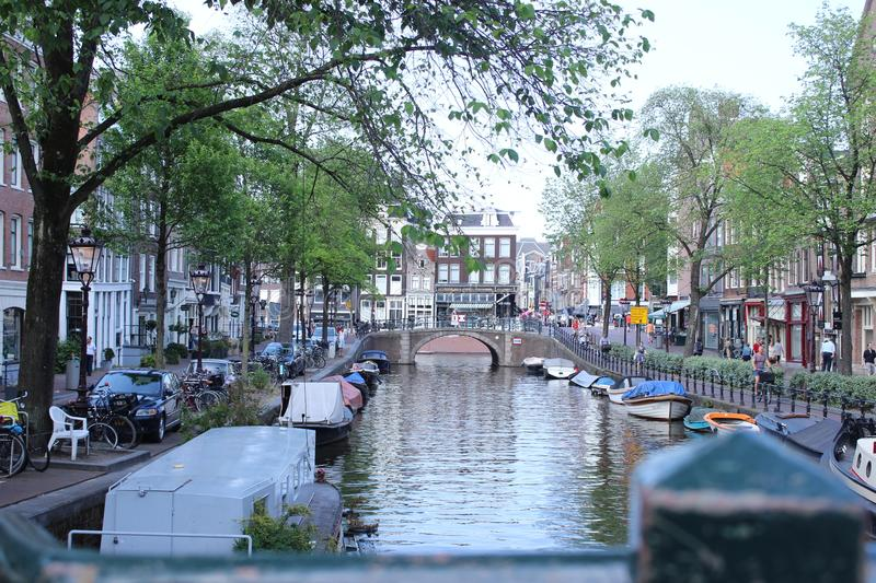 Quite canal from Amsterdam with boats royalty free stock images