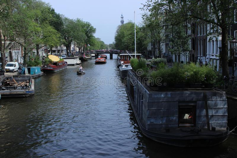 Quite canal from Amsterdam with boats stock photos