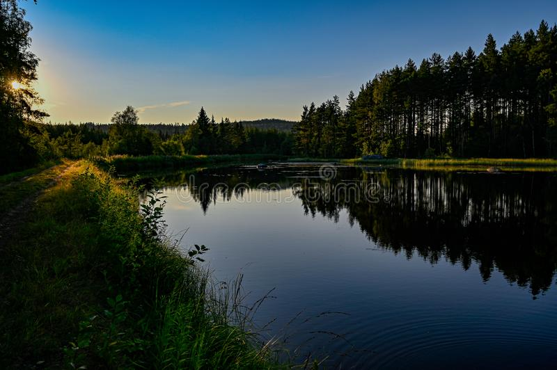 Calm channel water when the sun goes down. In Varmland Sweden july 2019 stock photos