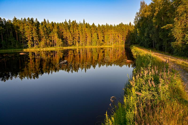 Calm channel water when the sun goes down. In Varmland Sweden july 2019 royalty free stock photos