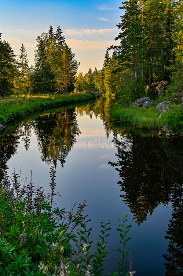 Calm channel water when the sun goes down. In Varmland Sweden july 2019 royalty free stock images