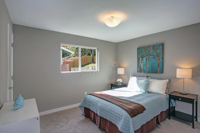 Calm and cozy bedroom with gray walls. stock photo