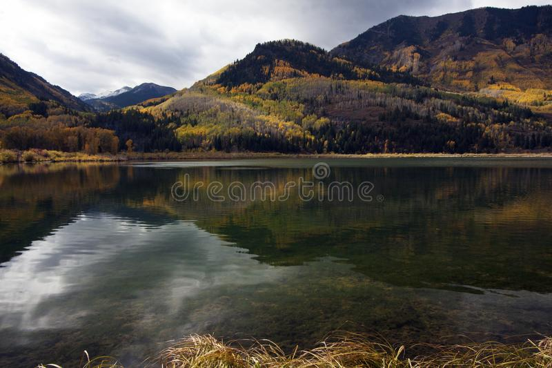 Autumn Reflections in Marble Lake, Colorado stock photography