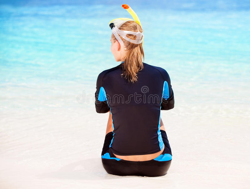 Calm diver girl on seashore royalty free stock image