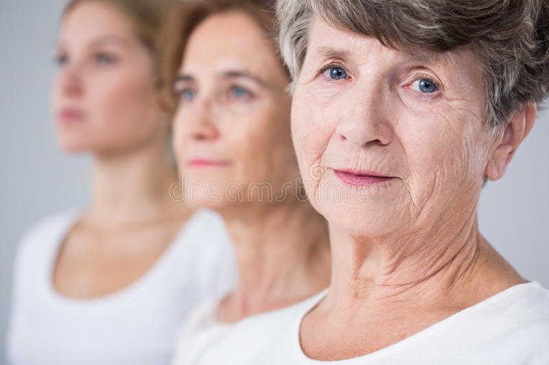 Calm elderly woman. Portrait of calm and beautiful elderly woman royalty free stock images