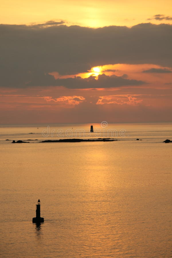 Calm English Channel with silhouette buoys royalty free stock image