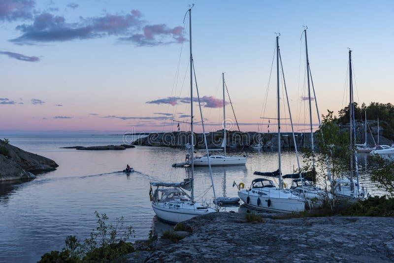 Calm evening natural harbor Stockholm archipelago. Calm evening in natural harbor at Sadelöga in outer skerries of Stockholm southern archipelago. Sweden royalty free stock image