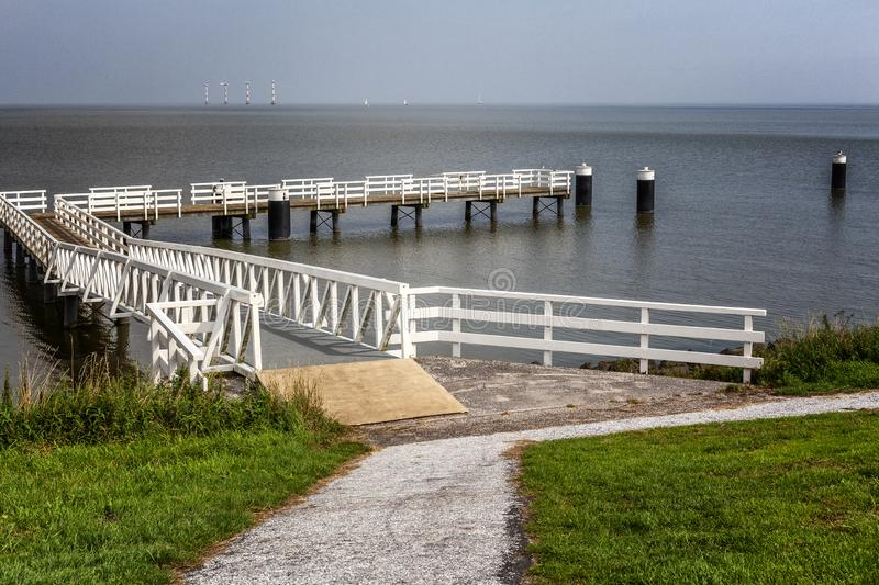 Calm expanse of water with a pier for ships royalty free stock image