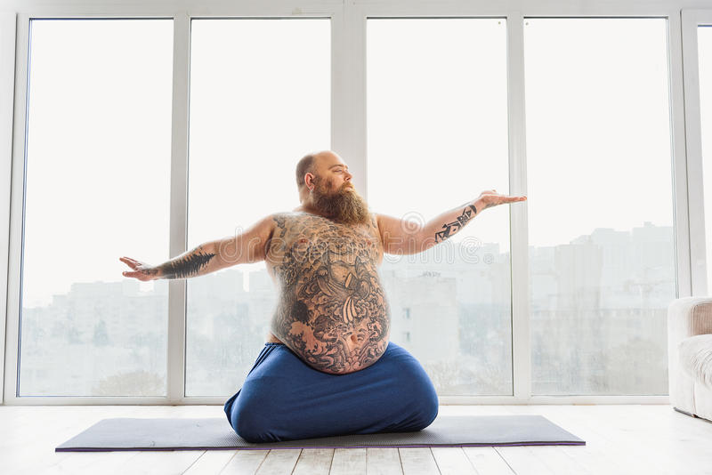 Calm Fat Man Meditating Near Window Stock Photo Image Of