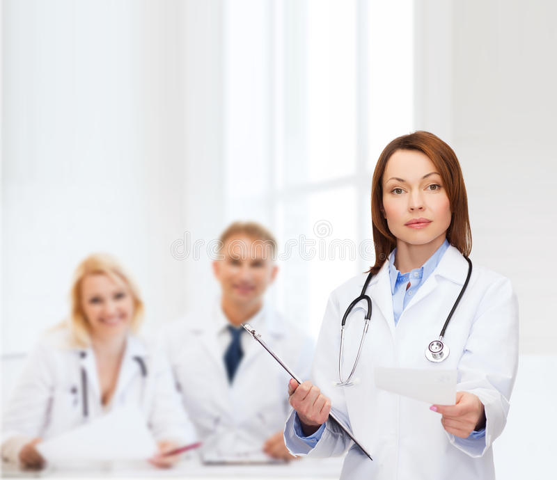 Download Calm Female Doctor With Clipboard Stock Image - Image: 39638315