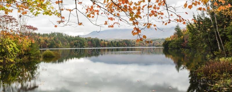 Waterbury Lake Autumn Panorama. A calm foggy Autumn morning on the Waterbury Reservoir in Waterbury, Vermont stock photos