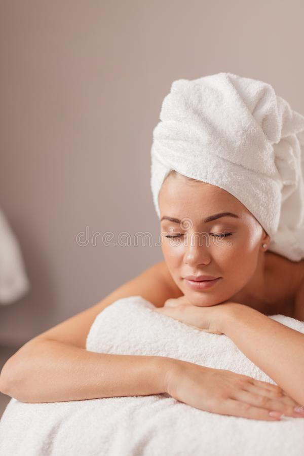Calm girl is waiting for massage stock photos