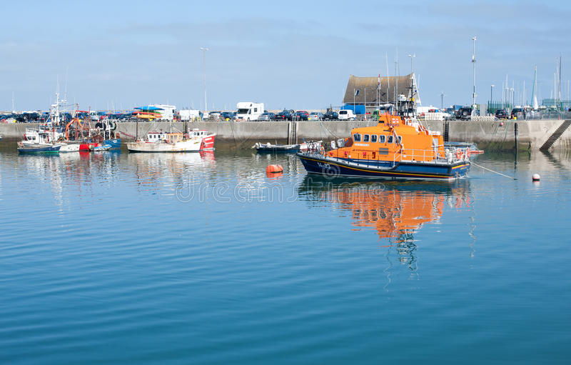 Calm howth harbour scene view with lifeboat royalty free stock images