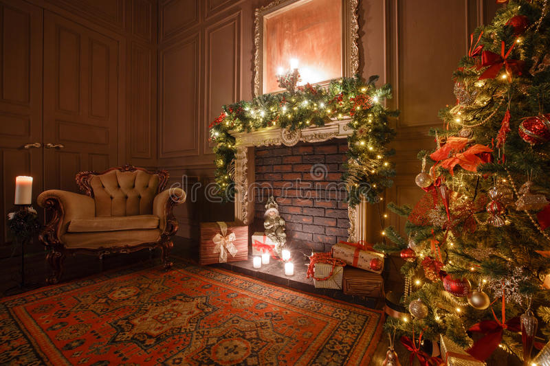 Calm image of interior Classic New Year Tree decorated in a room with fireplace royalty free stock photos