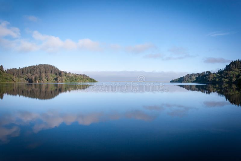 Humboldt Lagoons in Early Morning. A calm lagoon in the Humboldt National Lagoons State Park in California on an early morning, reflected in the water stock photos