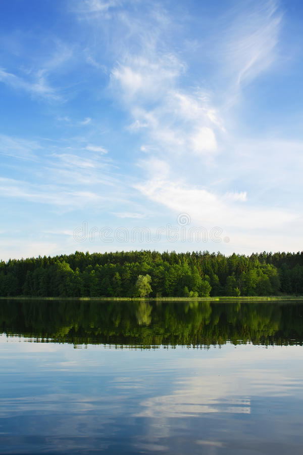 Calm lake. At sunset, view from fishing boat stock image
