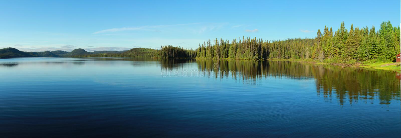 Calm lake in Canada. Beautiful and calm lake in Quebec, Canada royalty free stock photos