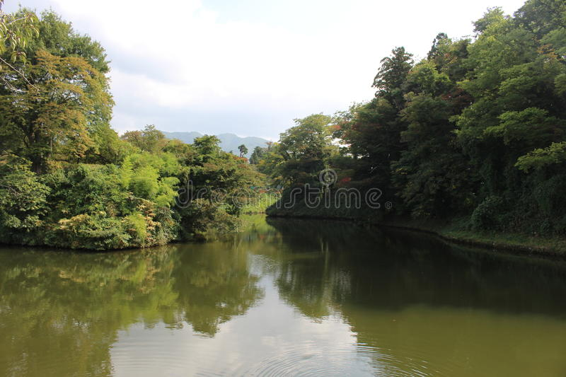 Calm lake. With reflection in cloudy day, Japan royalty free stock image