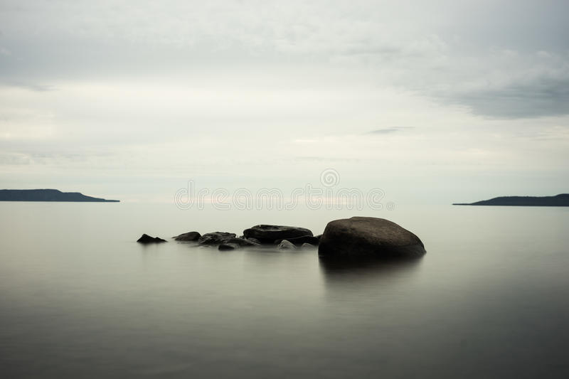 Calm Lake Rocks with cool colors stock photography