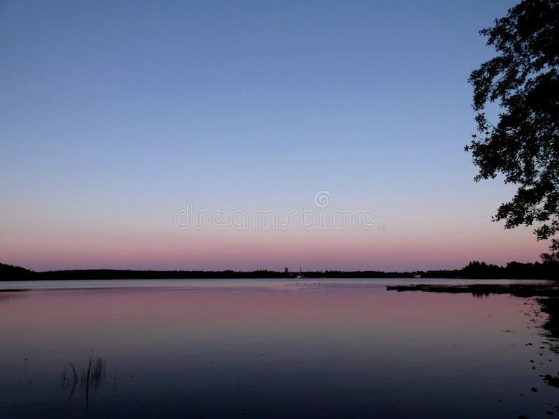 Calm lake sunset. Sunsets, sunsetlovers, beauty, beautyinnature, calmness, evening, beautifulnature, lakeviee, lakeview, finnishlake stock photos