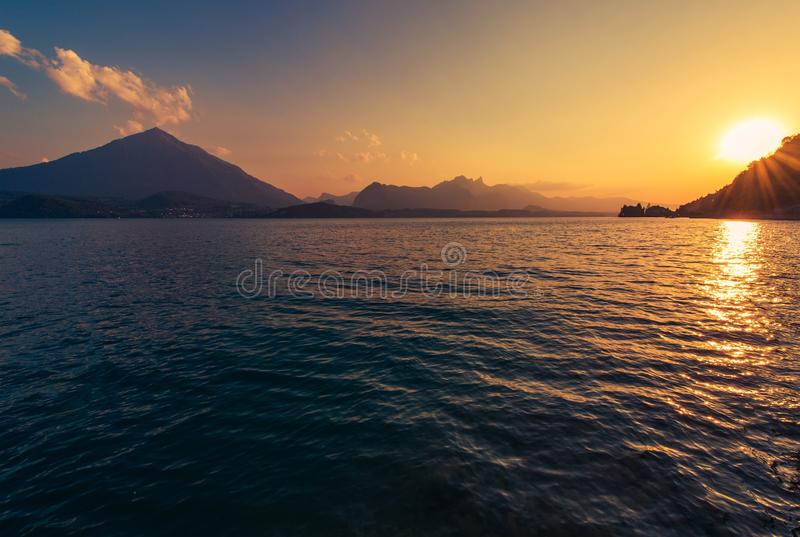 Calm Lake Thun Sunset. In the Switzerland Jungfrau Area. Summer Scenery royalty free stock photo