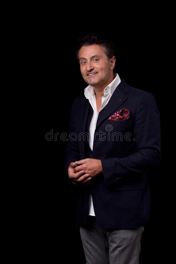 Calm man putting his hands together while posing for the photo royalty free stock image