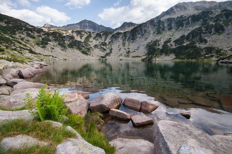 Calm Mountain Lake and Rocks stock photo