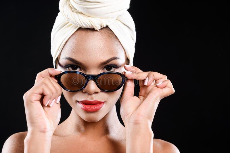 Calm mulatto woman is wearing sunglasses stock photos
