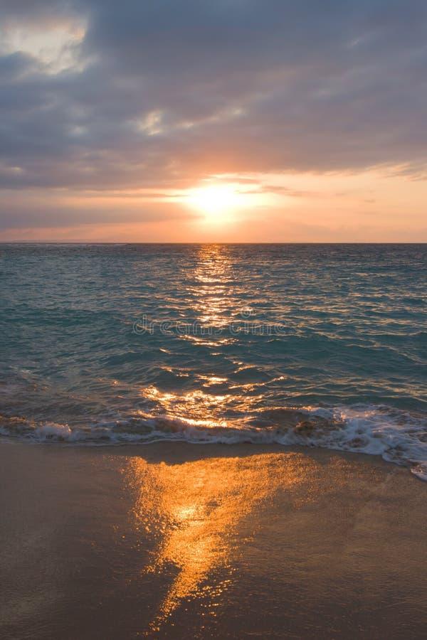 Calm ocean and beach on sunrise stock images