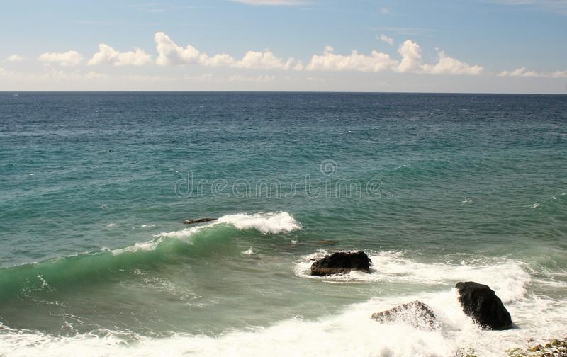 Calm ocean seas background and a blue sky with white clouds. Beautiful ocean seas and a blue sky with white clouds stock photos