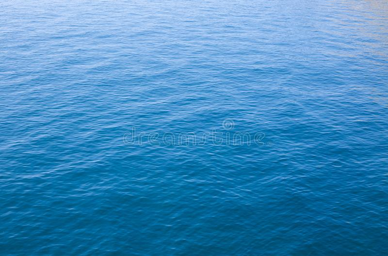 Calm ocean texture. Calm wave in the ocean in a soft backlight stock photo