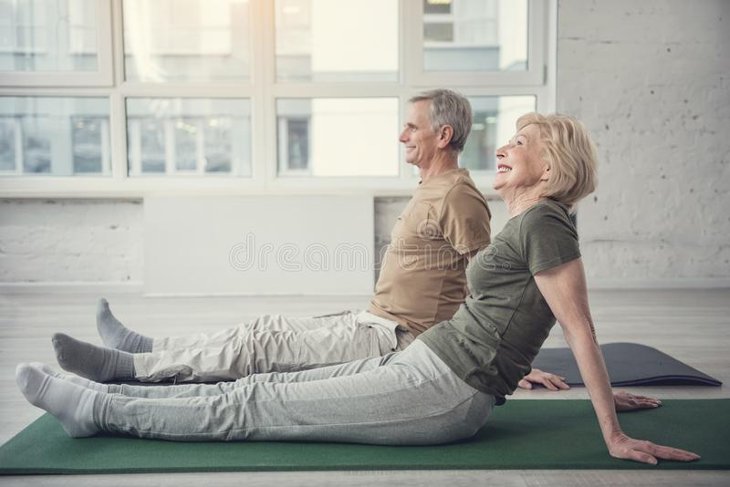 Calm old people relaxing after aerobics royalty free stock photo
