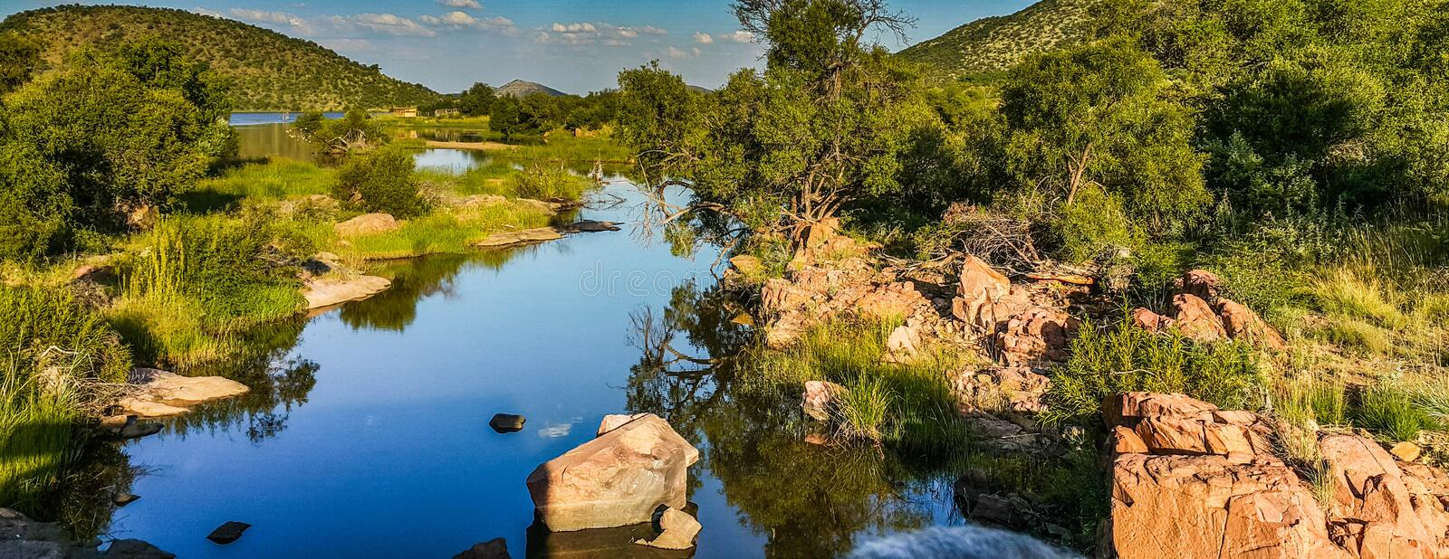 Calm River. Reflection and landscape in South Africa stock photo