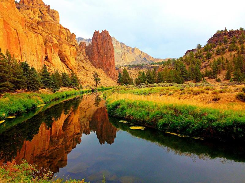 Calm River Winding Through Canyon stock images