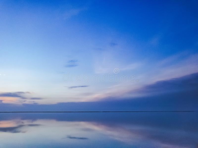Calm scene on ocean. Multicolored seascape view during blue hour stock photos