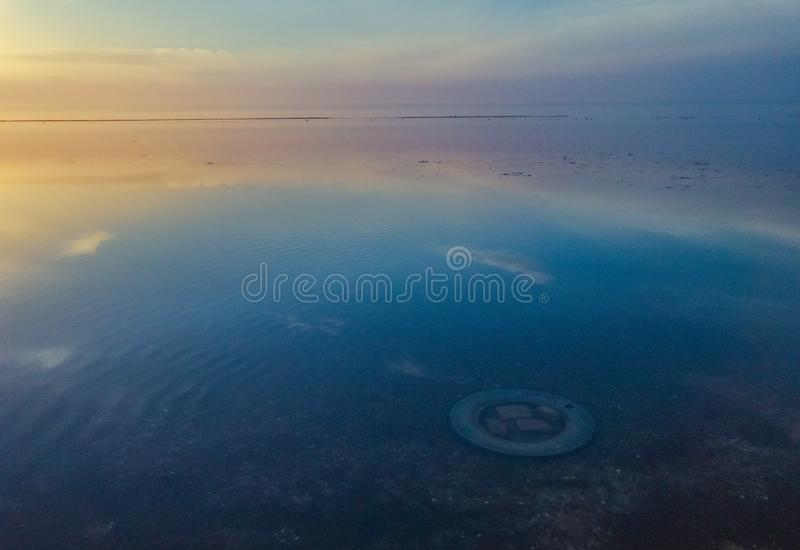 Calm scene on ocean. Multicolored seascape view during blue hour royalty free stock images