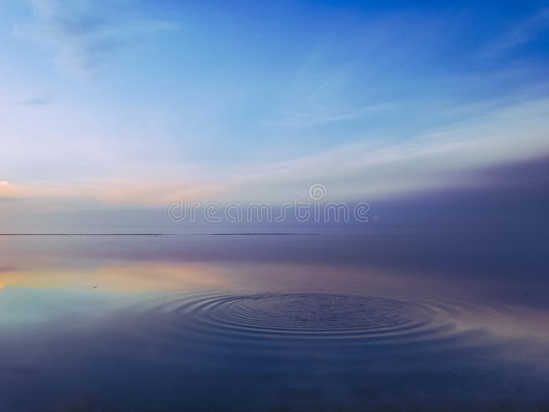 Calm scene on ocean. Multicolored seascape view during blue hour stock images