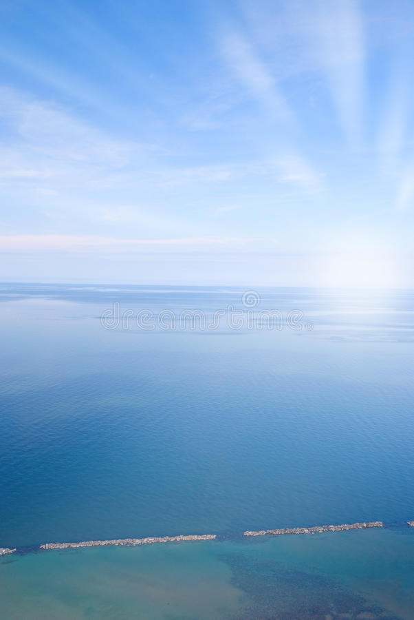 Calm sea. Under blue sky in summer stock photography