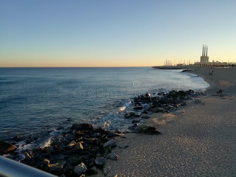 Calm sea in Badalona. Beach, rocks royalty free stock photos