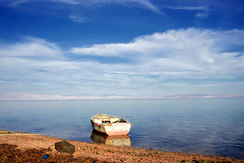 Calm sea. Gulf of Aqaba in a calm weather. The fishing boat on the water.Dahab. Egypt royalty free stock image