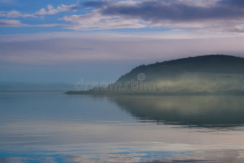 Calm sea and hill stock images