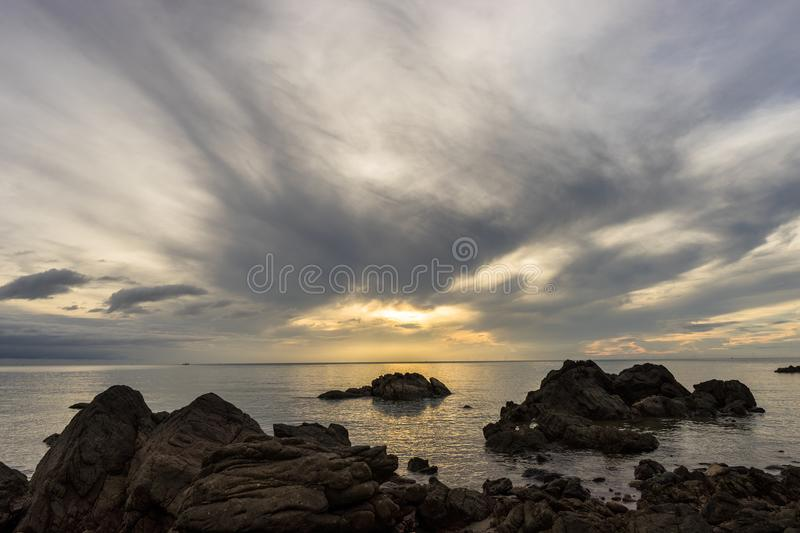 Calm sea in Morning light with flow cloudy. Calm sea in Morning light with colorful sky with cloudy stock image