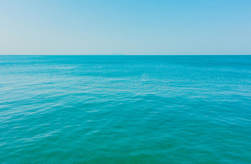 Calm Sea Ocean. And Blue Clear Sky Background royalty free stock photo