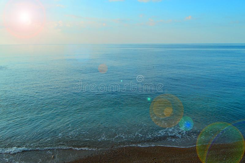 Calm sea ocean and blue sky background, sunrise over the sea, beautiful background royalty free stock image
