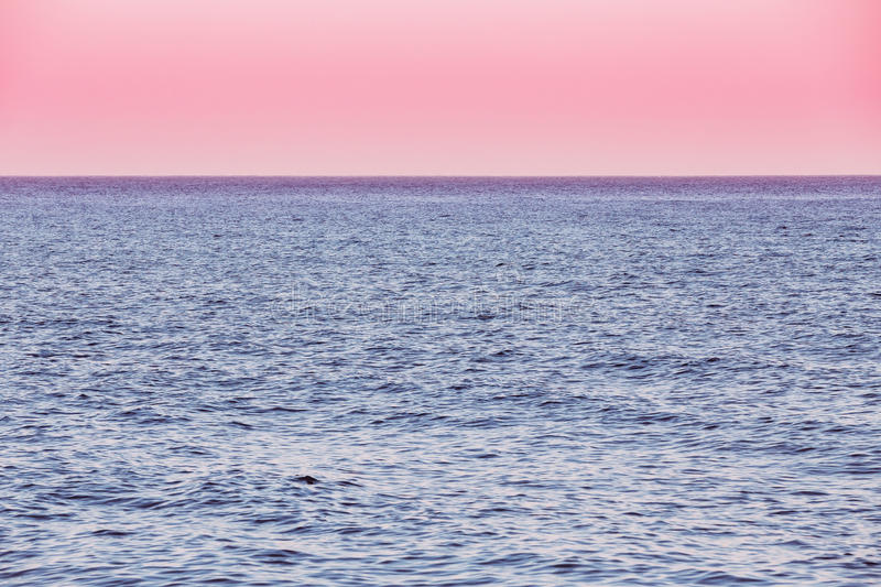 Calm Sea Ocean And Pink Sky Sunset Sunrise Background. Calm Sea Ocean And Pink Red Sky Sunset Sunrise Background stock images