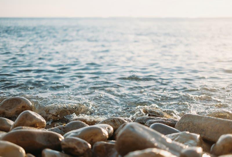 Calm sea. Pebble coast and calm sea royalty free stock image